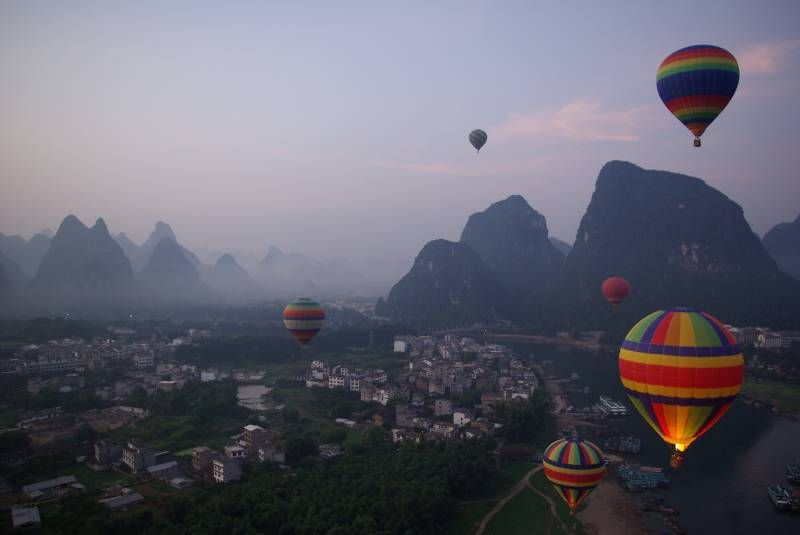Hot air balloons over Yangshuo at dawn.